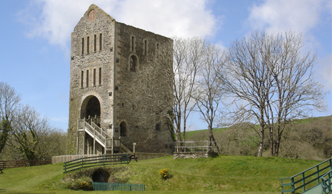 an outdoor snapshot of a large 4 story stone building