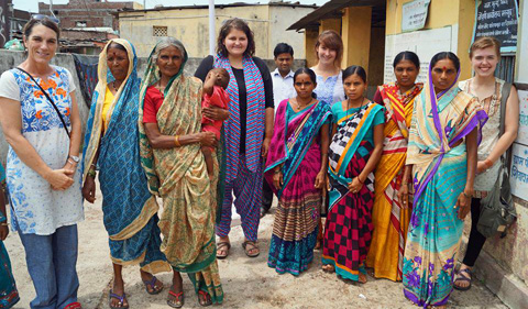 Grace Eberly meeting with female health center workers in the village of Marsul, India during a study abroad experience (2015).