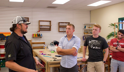 Instructor Oestrike and students brainstorm possible projects at the Athens MakerSpace