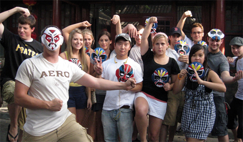 OHIO students posing in martial art gesture while showing off their own design of the Peking Opera face masks, Summer Chinese Language & Culture Program, Beijing, China, 2009