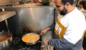 """Majid Zailaee, the President of the International Student Union (ISU), helps with preparing """"Foul"""" or broad beans the Saudi way"""