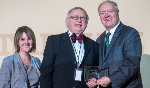 From left, Carly Leatherwood, Tadeusz Malinski and M. Duane Nellis at the 2019 faculty newsmakers gala