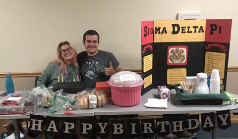 Olivia Strutervant and Vinny Lyons at the Sigma Delta Pi bake sale.