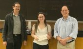 Drs. Paul King and David Tees present a First Prize certificate to Miranda Carver
