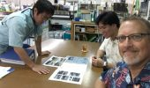 Viewing documents related to the lost-then-found fishing vessel from Iwate: Masaru Yonashiro of the Kinjo-cho town hall, Koudai Nakada and Chris Thompson.