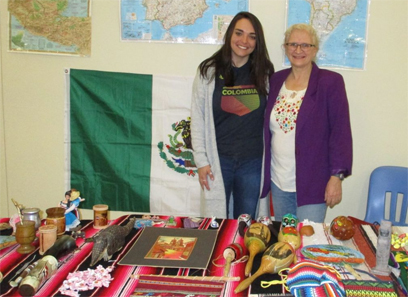 Spanish graduate student Carli Henman and Dr. Betsy Partyka pose at the Bunsold Middle School Hispanic Cultural Celebration.