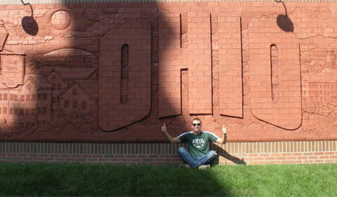 Patrick Denbow in front of the OHIO mural.