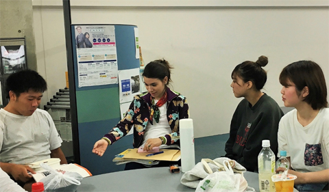 Olga Sormaz talks to students during the lunch table English conversation hour.