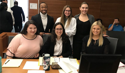 Alumni help with mock trial team preparation.