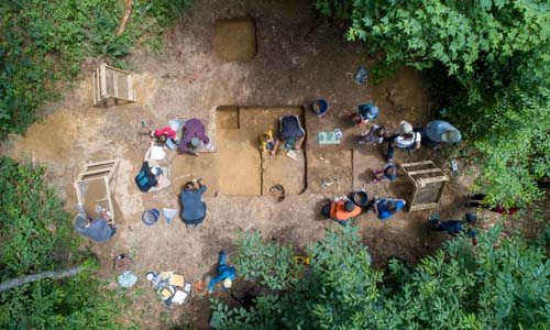 Students and community members excavate a site in the Wayne National Forest as part of the Archaeology field school.