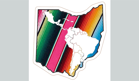 An outline of Ohio filled with a rainbow-colored Mexican blanket. Inside the Ohio, on top of the blanket is a white outline of Latin American countries.