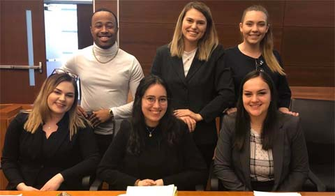 Prosecution team competes in Columbus, shown in group photo.