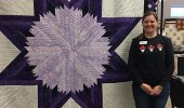 Frisch with the star quilt she made. Courtesy of Janice E. Frisch