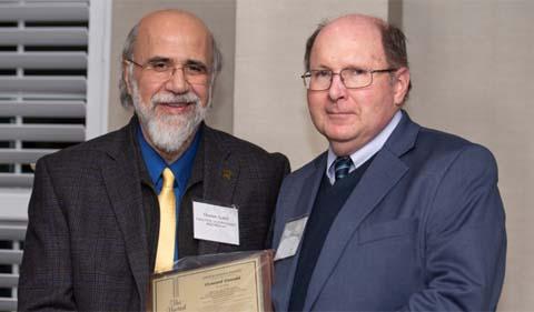 From left, Provost Chaden Djalal and Dr. Howard Dewald