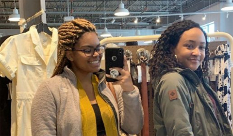Danita Pitts-Medley, left, and a friend shopping, taking a selfie in a store,