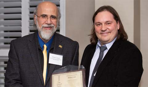 From left, Provost Chaden Djalali and Dr. Michael Held. Photo by Haldan Kirsch.