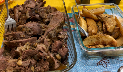 Traditional roast lamb and oven-roasted potatoes