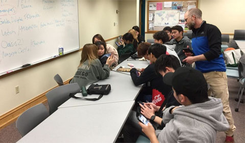 "Sabraw with Chubu students, brainstorming ideas and looking up Aichi symbols on their phones for the ""sibling mural"" in February."