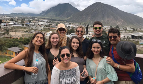 Ecuador group photo, with mountains in the background
