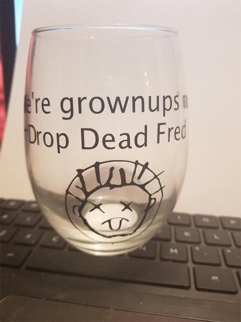 Glass with We're grownups to drop dead Fred