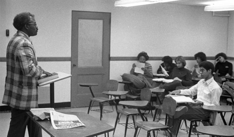 """Dr. Vattel """"Ted"""" Rose, Ohio University African American Studies chair, classroom lecture, 1980."""