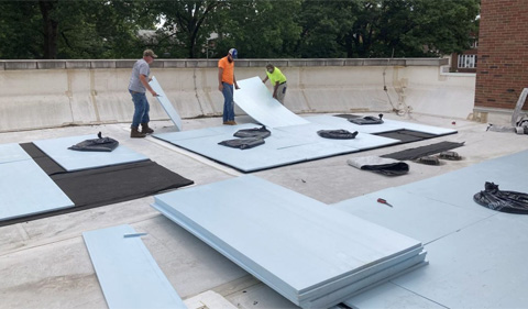 Roofing drainage pads and membranes are added to the rooftop.