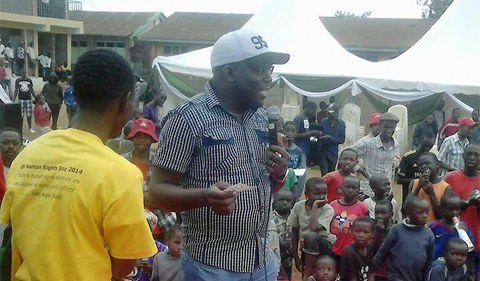 Alumnus Aggrey Otieno addresses a crowd in Korogocho, Kenya.
