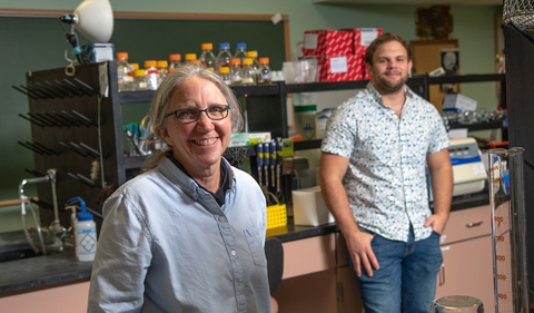 Postdoctoral researcher Alexander Meyers (Right) with Sarah Wyatt in her lab.