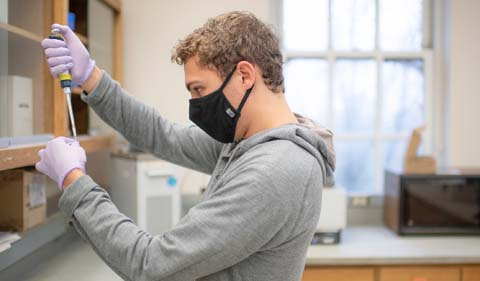 Jackson Krejsa, working in the lab