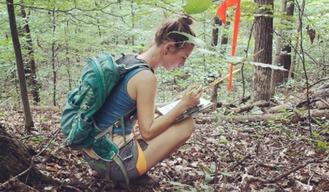Delaney Gibbs, working in the woods
