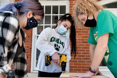 From left, Alex Sines, Abby Vanbuskirk and Fiona Daviswork on bat house construction.