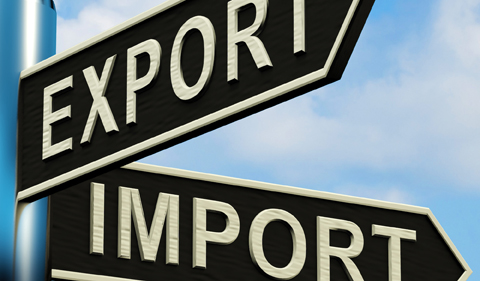 Export Or Import Directions On A Metal Signpost