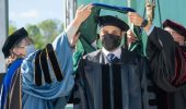 Ali Aldhumani gets hooded at graduate commencement at Ohio University 2021.