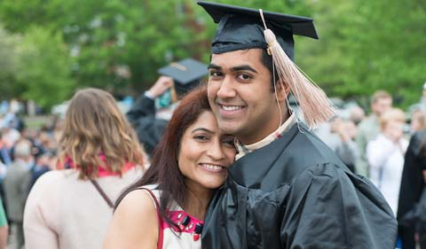 Rahul Patel gets a hug from his mother Jenny Patel at undergraduate commencement 2016.