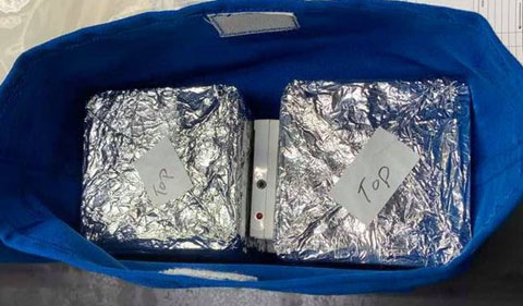 """The science kit gets wrapped up in aluminum foil, with """"top"""" written on pieces of tape so that the launch orientation is correct. Back on Earth, the ground control experiment will be in a NASA chamber that matches the environment of the ISS Veggie Unit—with gravity being the variable."""