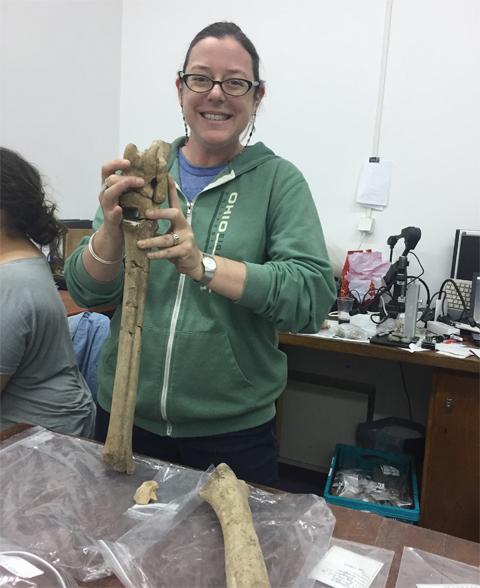 Sabrina Curran holding giraffe leg