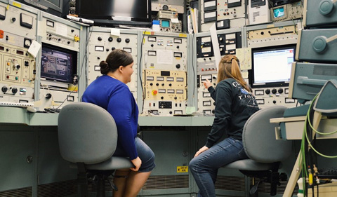 Andrea Richard and KristynBrandenburg at the console in the Edwards Accelerator Lab.