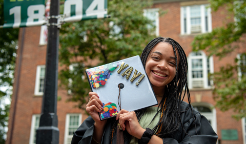 Peyton Hendricks poses after walking in the 2020 Commencement Ceremony on Sept. 5, 2021.