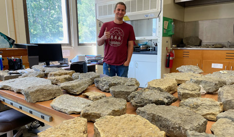 Ian Forsythe with fossils collected in the field displayed back in the lab in Clippinger.